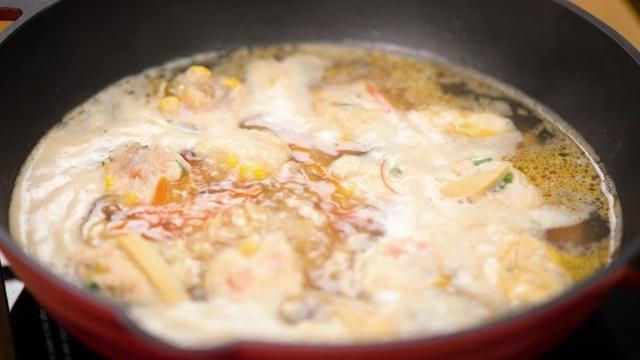 simmering cooking bakwan kepiting