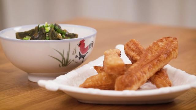 A plate of frozen prata youtiao with century egg chicken porridge