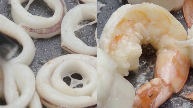 Half cooked squid rings and prawns