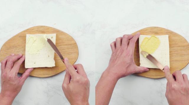 Spread mayonnaise and Dijon mustard on bread