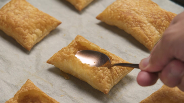 Pressing spoon into puff pastry