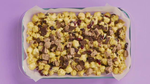 Chopped LAKTO cheese curd bar on popcorn mix in a baking dish
