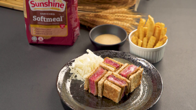 Beef katsu sandwich with french fries and sunshine enriched soft meal whole grain bread