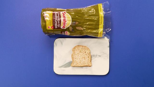 Sunshine bakeries Australian oat soft grain bread on chopping board