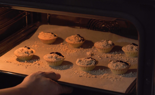 Berries and Crumble tart in oven